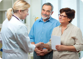 nurse shaking hands to client