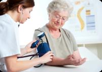nurse checking patient's blood pressure
